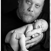 "Mr. Dwayne Kemp, composer and 3D creator with her ""two day old"" little girl"