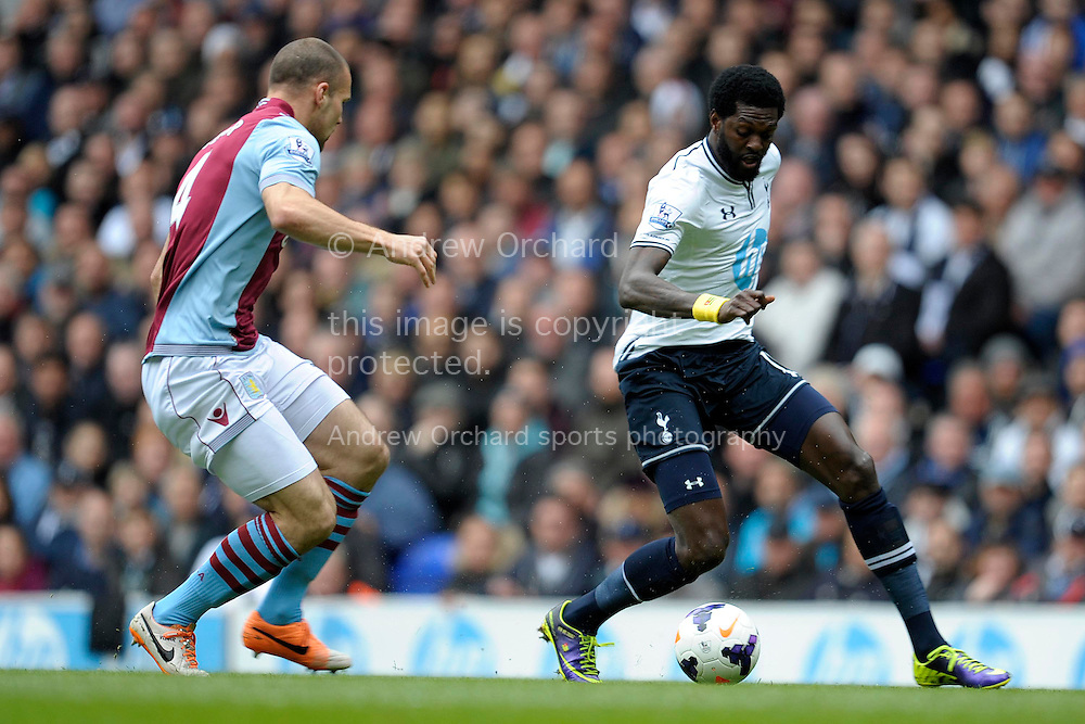 Tottenham Hotspur's Emmanuel Adebayor competes with Aston Villa's Ron Vlaar . Barclays premier league match ,Tottenham Hotspur v Aston Villa at White Hart Lane in Tottenham, London  on Sunday 11th May 2014.<br /> pic by John Patrick Fletcher, Andrew Orchard sports photography.
