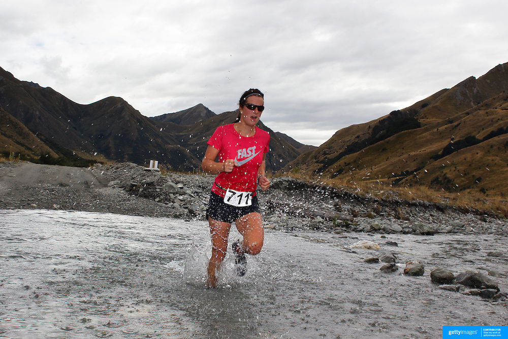 Runner Julia Hegar  crosses  Moke Creek on the Ben Lomond High Country Station while winning the female 16-39 10Km  race during the Pure South Shotover Moonlight Mountain Marathon and trail runs. Moke Lake, Queenstown, New Zealand. 4th February 2012. Photo Tim Clayton
