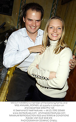 MR EVY HAMBRO a member of the banking family and MISS ANNABEL ROPNER, at a party in London on 2nd December 2002.	PFU 124