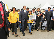 South Korea's presidential front-runner Moon Jae-In (2nd L, front) of Democratic Party of Korea (DPK) walks together with family members of victims of Sewol ferry disaster after an event marking the third anniversary of the ferry disaster in Ansan, about 40 km (25 miles) southwest of Seoul, South Korea, Apr 16, 2017. The Sewol Ferry sank off South Korea's southwestern coast near Jindo on April 16, 2014 during a journey from Incheon to Jeju. The Ferry was carrying 475 crew and passengers, mostly high school students on a school trip. More than 300 people died and nine are still missing. South Korea's presidential election will be held on May 9, 2017. Photo by Lee Jae-Won (SOUTH KOREA) www.leejaewonpix.com