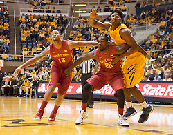 West Virginia Mountaineers forward Devin Williams (5) looks to grab a rebound over Iowa State Cyclones forward Dustin Hogue during the first half at the WVU Coliseum.