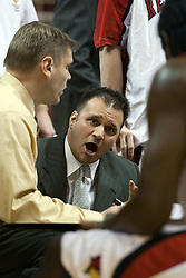 15 January 2005<br /> <br /> Assistant Coach Chris Jans addresses his team during a time out as the Illinois State University Redbirds keep the Drake Bulldogs on a leash as they pull ahead in the 2nd half for a74 - 61 Victory.  Redbird Arena, Illinois State University, Normal IL