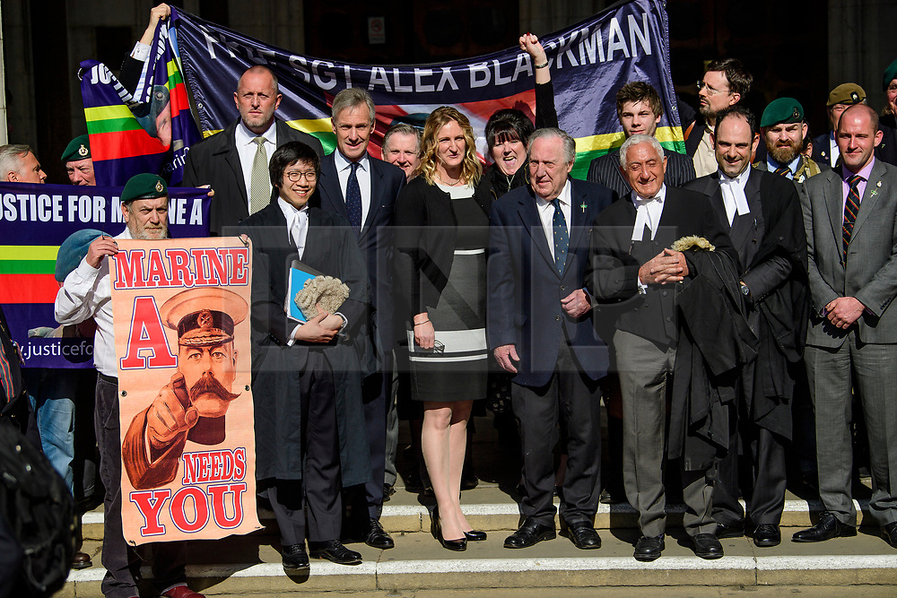 © Licensed to London News Pictures.15/03/2017.London, UK.  CLAIRE BLACKMAN (C), wife of Sergeant Alexander Blackman, cposes for a photograph with former Royal Marines as she leaves the Royal Courts of Justice in London, where a judge reduced the conviction of Sgt Blackman from Murder to Manslaughter, on appeal.  Also known as Marine A, Sgt Blackman was appealing a life sentence for the murder of a wounded Taliban fighter in Afghanistan in 2011.Photo credit: Ben Cawthra/LNP