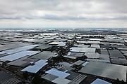 Nederland, Zuid-Holland, Gemeente Westland,  22-05-2011; Westland, kassengebied met de bebouwing van Naaldwijk en 's-Gravenlande. <br /> Greenhouse area between The Hague and Rotterdam.<br /> luchtfoto (toeslag), aerial photo (additional fee required)<br /> copyright foto/photo Siebe Swart
