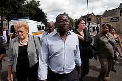 © Licensed to London News Pictures. 07/08/2011. Tottenham, UK.Tottenham MP David Lammy arrives to survey the devestation in Tottenham following a night of rioting, vandalism and looting. Photo credit : Joel Goodman/LNP