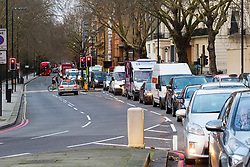 PICTURED: Rush hour traffic is at a standstill on Notting Hill Gate as anti-pollution protesters block the rush hour traffic at Marble Arch.<br />  Demonstrators from the anti-pollution group Stop Killing Londoners cause traffic chaos for London commuters as they conduct a series of short roadblocks at Marble Arch stopping cars and buses from entering Oxford Street and Park Lane. Irate motorists accused them of creating more pollution than they were stopping, whilst the group said their objectives were long term. A leaflet handed out to motorists says the government is not doing enough to tackle the crisis costing 'taxpayers and the NHS &pound;billions [sic] a year'. PLACE, January 29 2018. &copy; Paul Davey