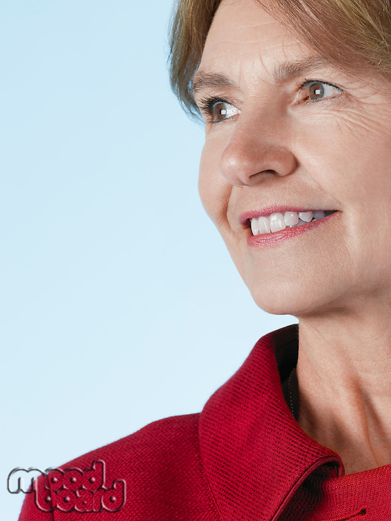 Middle-aged woman looking away and smiling close-up