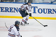 Robert Morris defenseman Tyson Wilson skates the puck up ice during the Atlantic Hockey final against RIT at the Blue Cross Arena in Rochester on Saturday, March 19, 2016.