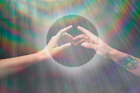 Two hands connecting in a rainbow circle.