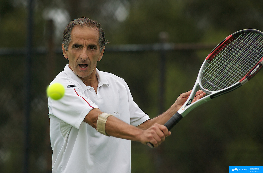 Jorge Camina Borda, Spain, in action during the doubles match against France  in the Von Cramm Cup during the 2009 ITF Super-Seniors World Team and Individual Championships at Perth, Western Australia, between 2-15th November, 2009.