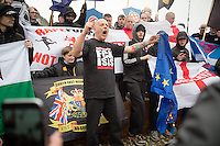 @Licensed to London News Pictures 02/04/2016. Dover, Kent. The EU flag being torched today by far right demonstrators in Dover. Pro and anti-refugee demonstrators descend upon the streets of Dover today accompanied by a heavy police presence. Photo credit: Manu Palomeque/LNP