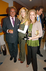 Left to right, WILLIAM TALLON former aid of the late Queen Elizabeth the Queen Mother, BASIA BRIGGS and CAROLYN DAILEY Vice President & Senior Strategic Advisor Public Policy, Time Warner, at a party to celebrate the publication of Diana by Sarah Bradford held at 80 The Strand, London on 27th September 2006.<br />