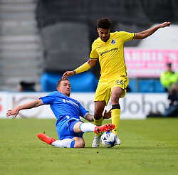 Jake Clarke-Salter of Bristol Rovers escapes the tackle of Cody McDonald of Gillingham - Mandatory by-line: Alex James/JMP - 14/04/2017 - FOOTBALL - MEMS Priestfield Stadium - Gillingham, England - Gillingham v Bristol Rovers - Sky Bet League One