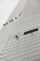 © Licensed to London News Pictures. 16/08/2012. LONDON, UK. Window cleaners hang by ropes from the Shard skyscraper in London today. Photo credit: Matt Cetti-Roberts/LNP