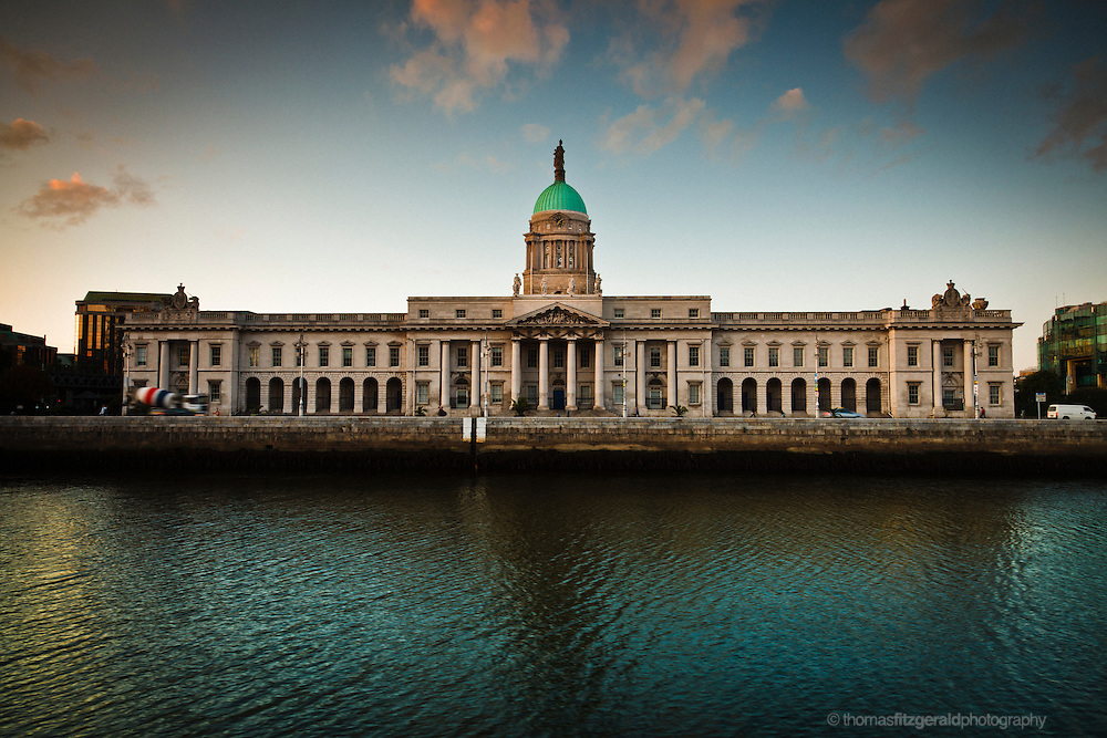 Iconic Dublin Customs House at Sunset with reflections in the River Liffey