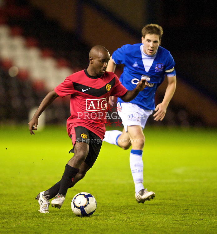 WIDNES, ENGLAND - Tuesday, October 6, 2009: Manchester United's Febian Brandy in action against Everton's Dan Gosling during the FA Premiership Reserves League (Northern Division) match at the Halton Stadium. (Pic by David Rawcliffe/Propaganda)