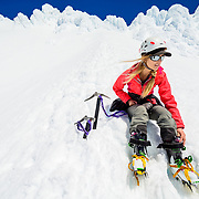 Noelle Synder switching from ski to crampons on Mount Hood