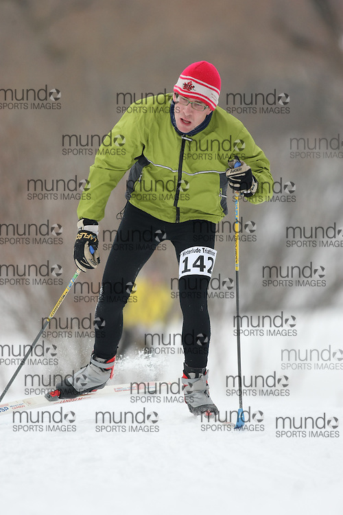 Ottawa, Canada ---07/02/09---BRIAN MCARTHUR of RED DEER finished in 20 overall  2009 WinterludeTriathlon. It is a speed skate, cross country ski, run version of the triathlon. Photo copyright Sean Burges/Mundo Sport Images, 2009.