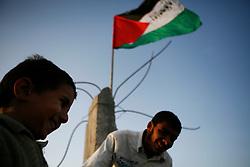 Palestinian children sit atop their home destroyed by Israel in Jabaliya in the Gaza Strip.