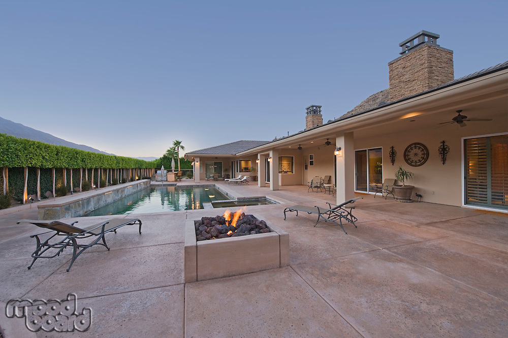 House exterior with swimming pool in backyard