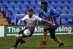 Danny Lloyd of Peterborough United in action with Aristote Nsiala of Shrewsbury Town - Mandatory by-line: Joe Dent/JMP - 24/04/2018 - FOOTBALL - Montgomery Waters Meadow - Shrewsbury, England - Shrewsbury Town v Peterborough United - Sky Bet League One