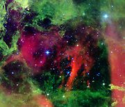 Infrared image from NASA's Spitzer Space Telescope showing the Rosette nebula, a pretty star-forming region more than 5,000 light-years away in the constellation Monoceros. lurking inside this delicate cosmic rosebud are so-called planetary 'danger zones' (see spheres illustrations in figure 1). These zones surround super hot stars, called O-stars (blue stars inside spheres), which give off intense winds and radiation. Young, cooler stars that just happen to reside within one of these zones are in danger of having their dusty planet-forming materials stripped away. This image shows infrared light captured by Spitzer's infrared array camera. Light with wavelengths of 24 microns is red; light of 8 microns is green; and light of 4.5 microns is blue.