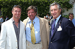 """Left to right, DAVID COULTHARD, JOHANN RUPERT Chief Executive of Richemont and ARNAUD BAMBERGER at a luncheon hosted by Cartier at the 2005 Goodwood Festival of Speed on 26th June 2005.  Cartier sponsored the """"Style Et Luxe' for vintage cars on the final day of this annual event at Goodwood House, West Sussex. <br /><br />NON EXCLUSIVE - WORLD RIGHTS"""
