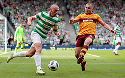Celtic's Scott Brown (left) competes with Motherwell's Liam Grimshaw during the William Hill Scottish Cup Final at Hampden Park, Glasgow.