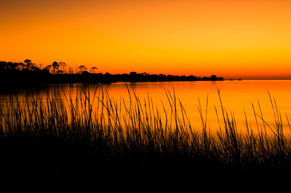 A wildly orange sunset over St. George Island on the Florida Panhandle. Even though the mosquitoes were awful and something big was buzzing around my head, the end result was  very worth it.