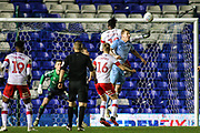 Kyle McFadzean of Coventry City (5) out jumps Freddie Ladapo of Rotherham United (10) during the EFL Sky Bet League 1 match between Coventry City and Rotherham United at the Trillion Trophy Stadium, Birmingham, England on 25 February 2020.