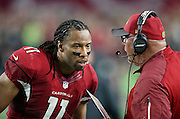 Arizona Cardinals head coach Bruce Arians talks to Arizona Cardinals wide receiver Larry Fitzgerald (11) near the sideline during the NFL NFC Divisional round playoff football game against the Green Bay Packers on Saturday, Jan. 16, 2016 in Glendale, Ariz. The Cardinals won the game in overtime 26-20. (©Paul Anthony Spinelli)