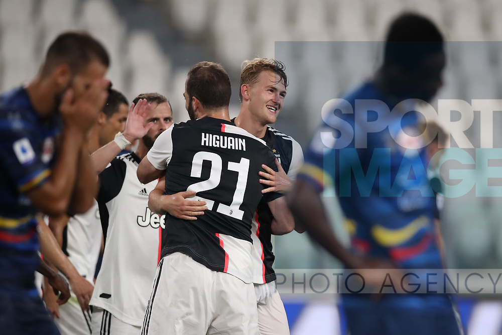 Juventus's Dutch defender Matthijs De Ligt celebrates with Juventus's Argentinian striker Gonzalo Higuain after scoring to give the side a 4-0 lead during the Serie A match at Allianz Stadium, Turin. Picture date: 26th June 2020. Picture credit should read: Jonathan Moscrop/Sportimage