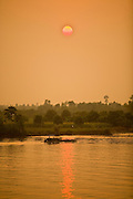 12 MARCH 2006 - CHAU DOC, AN GIANG, VIETNAM: Sunset on the Mekong River near Chau Doc in the Mekong River delta. The Mekong is the lifeblood of southern Vietnam. It is the country's rice bowl and has enabled Vietnam to become the second leading rice exporting country in the world (after Thailand). The Mekong delta also carries commercial and passenger traffic throughout the region.  Photo by Jack Kurtz