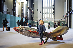 © Licensed to London News Pictures. 03/10/2016. London, UK. Olive, 3, interacts with the 'Anywhere' installation in the Tate Modern Turbine Hall by artist Philippe Parreno. Photo credit: Rob Pinney/LNP