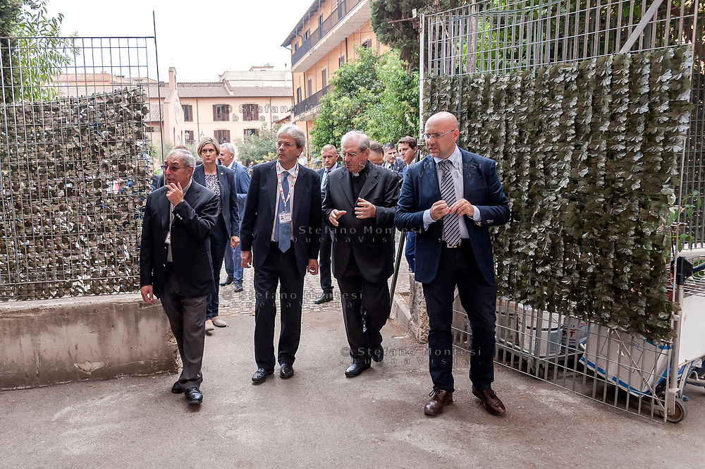 ROME, ITALY - SEPTEMBER 01: New vicar of Rome, Angelo De Donatis, Italian PM Paolo Gentiloni, the director of Caritas Rome, Msgr. Enrico Feroci , Simone Iannone General Secretary of Caritas of Rome during visit the Citadel of the Charity of the Diocesan Caritas of Rome on September 1, 2017 in Rome, Italy. Italian PM Paolo Gentiloni visited the Caritas to express the gratitude of all Italians to the world of volunteering, to those who work in favour of solidarity.