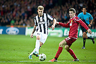 23.10.12. Copenhagen, Denmark. UEFA Champions League Group E, FC Nordsjaelland  1 vs Juventus 1 at the Parken Stadium. Bendtner (L) of Juventus fights for the ball during the UEFA Champions League..Photo: © Ricardo Ramirez.
