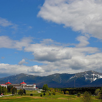 Omni Resort and Mount Washington in Bretton Woods, New Hampshire<br /> The Omni Hotel in Bretton Woods, New Hampshire has the historic splendor and charm from 1902 blended with modern amenities after an $80 million renovation.  In the background is Mount Washington. This snow-capped peak reaches an elevation of 6,288 feet, New England&rsquo;s tallest. The view is beautiful and majestic yet it is notorious for extreme weather. The mountain experiences hurricane-force winds for a third of the year. The strongest gust was measured at 231 m.p.h. In January, 2004, the temperature plunged to a wind chill of 103&deg; below zero.