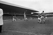 23/05/1965<br /> 05/23/1965<br /> 23 May 1965<br /> National Hurling League Final: Tipperary v Kilkenny at Croke Park, Dublin.<br /> Kilkenny's full back, P. Dillon (3), jumps high to clear the ball from J. McKenna, Tipperary's full forward.