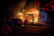 Firefighters work at the scene of a second-alarm house fire on the 800 block of West Middle Street, Saturday, March 17, 2018 in Hanover. No one was injured in the blaze, which came just hours after another house exploded in a three-alarm fire in Hanover.