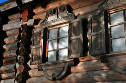 Sunlight dapples this traditional house on Kizhi Island, in Russia's Lake Onega. The island is home to the world-famous Transfiguration Church, a timbered marvel with 22 onion domes built without a single nail. Over the years a number of other traditional wooden structures have been moved from Karelia to preserve them, and the island is now a UNESCO World Heritage site.