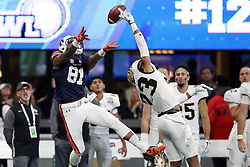 Auburn Tigers wide receiver Darius Slayton (81) fails to pull in a catch against UCF Knights defensive back Tre Neal (23) during the 2018 Chick-fil-A Peach Bowl NCAA football game on Monday, January 1, 2018 in Atlanta. (Jason Parkhurst / Abell Images for the Chick-fil-A Peach Bowl)