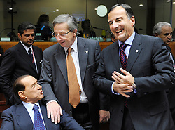 Jean-Claude Juncker, Luxembourg's prime minister, center, speaks with Silvio Berlusconi, Italy's prime minister, left, and Franco Frattini, Italy's foreign minister, right, during the European Summit, in Brussels, Belgium, Wednesday, Oct. 15, 2008.   (Photo © Jock Fistick)