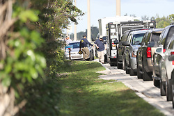 FBI personnel work a house at 7200 Locahatchee Road thought to be connected to the suspect in the shooting at Marjory Stoneman Douglas High School in Parkland, FL, USA, where 17 people were killed Wednesday. Photo by Amy Beth Bennett/Sun Sentinel/TNS/ABACAPRESS.COM