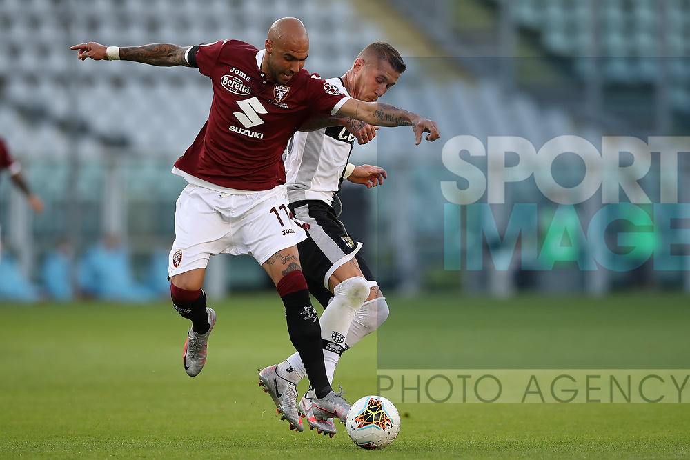 Torino FC's Italian striker Simone Zaza tussles with Parma Calcio's Slovak midfielder Juraj Kucka during the Serie A match at Stadio Grande Torino, Turin. Picture date: 20th June 2020. Picture credit should read: Jonathan Moscrop/Sportimage