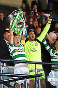 Celtic's Scott Brown (8) lifts the trophy during the Betfred Scottish Cup  Final match between Aberdeen and Celtic at Hampden Park, Glasgow, United Kingdom on 27 November 2016. Photo by Craig Galloway.