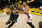 Golden State Warriors forward Draymond Green (23) takes the ball to the basket against Houston Rockets guard Chris Paul (3) during Game 4 of the Western Conference Finals at Oracle Arena in Oakland, Calif., on May 22, 2018. (Stan Olszewski/Special to S.F. Examiner)