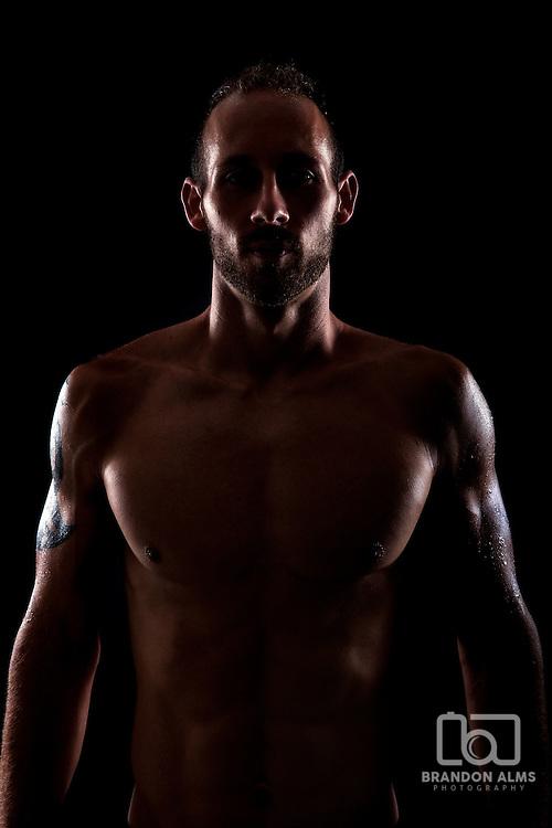 American Ninja Warrior contestant Adam Arnold posed in dramatic light