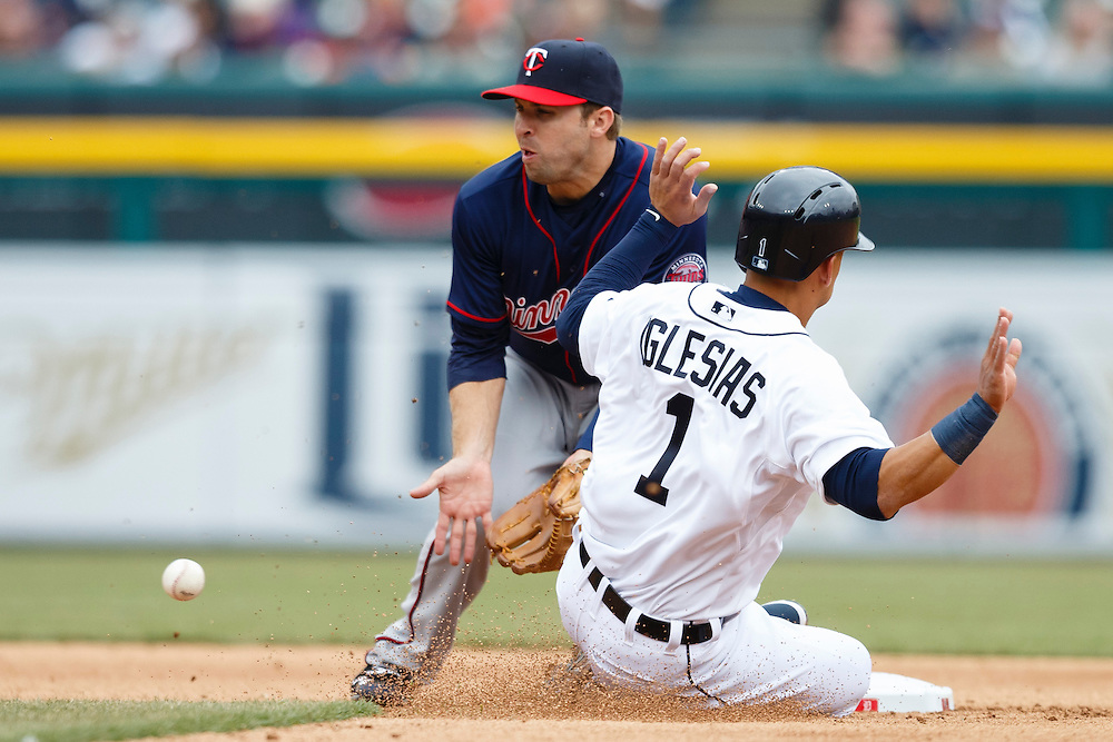 Apr 6, 2015; Detroit, MI, USA; Detroit Tigers shortstop Jose Iglesias (1) steals second base ahead of the throw to Minnesota Twins second baseman Brian Dozier (2) in the seventh inning at Comerica Park. Mandatory Credit: Rick Osentoski-USA TODAY Sports