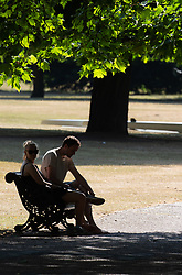 A couple rest in the shade in Hyde Park as another heatwave day begins with temperatures expected to soar. London, July 01 2018.